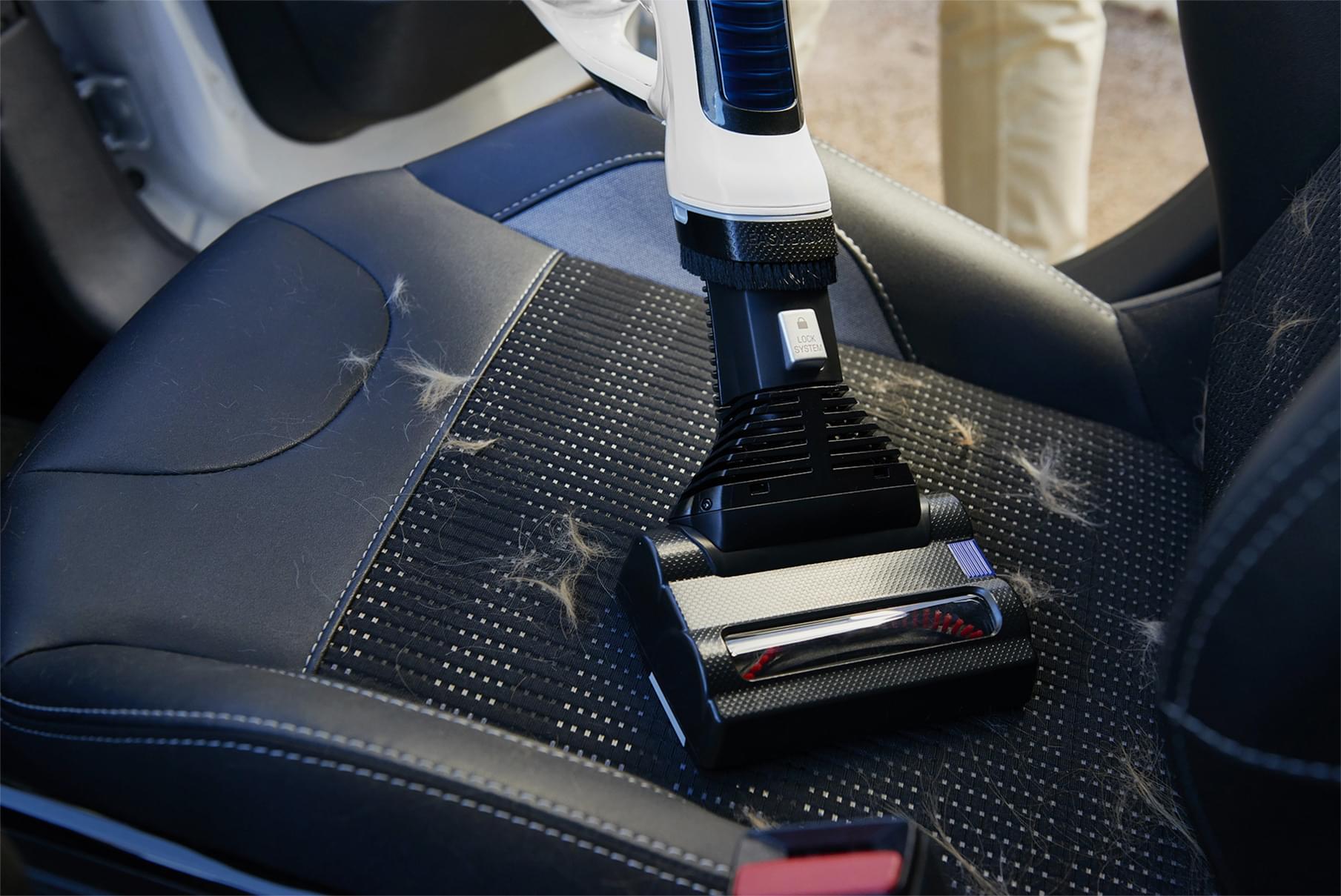 Mini electro brush in a car