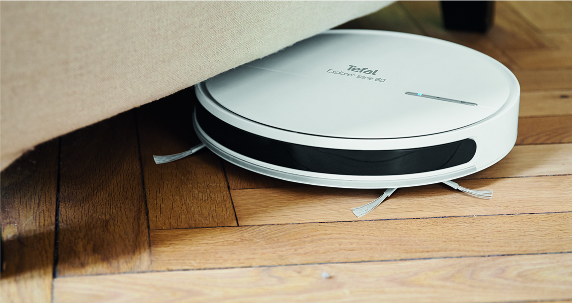 The ultra thin Explorer Serie 60 vacuuming under a sofa